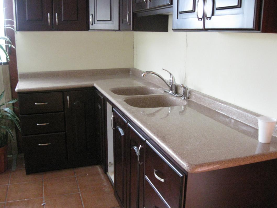 Sobre de cocina en escuadra sobres de granito sint tico for Granito natural para cocinas